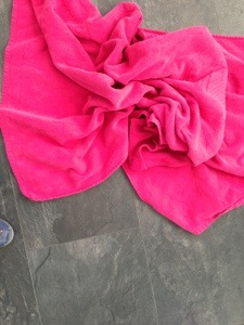 pink towel on black floor
