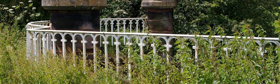 wrought iron fence with pillars